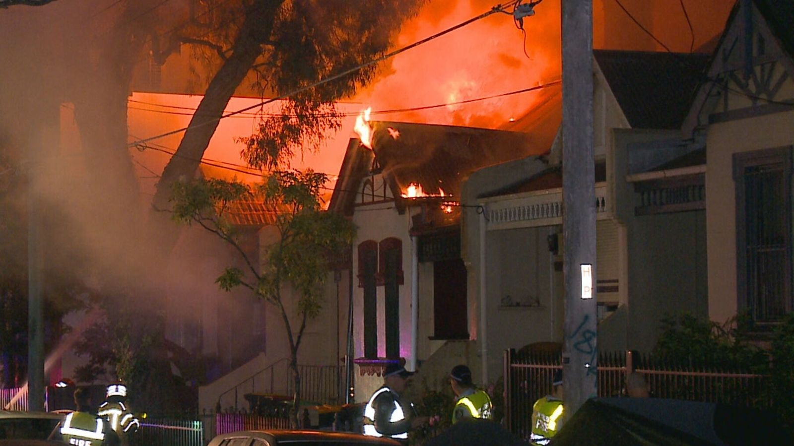 A fire has spread through a row of terrace homes in Newtown