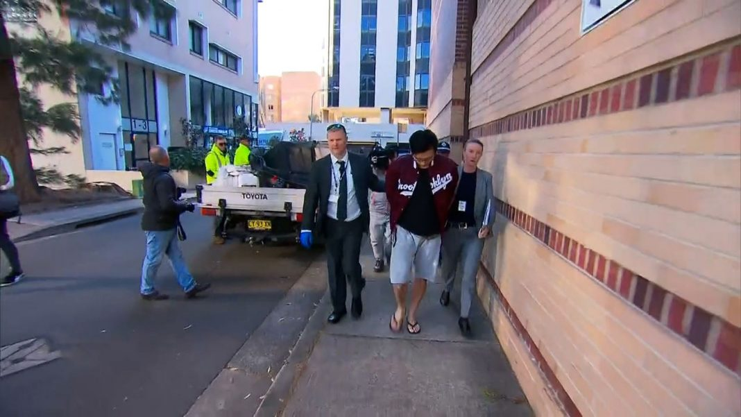 A man (centre) has been charged with allege ... t a home in Sydney's inner west. (9News)