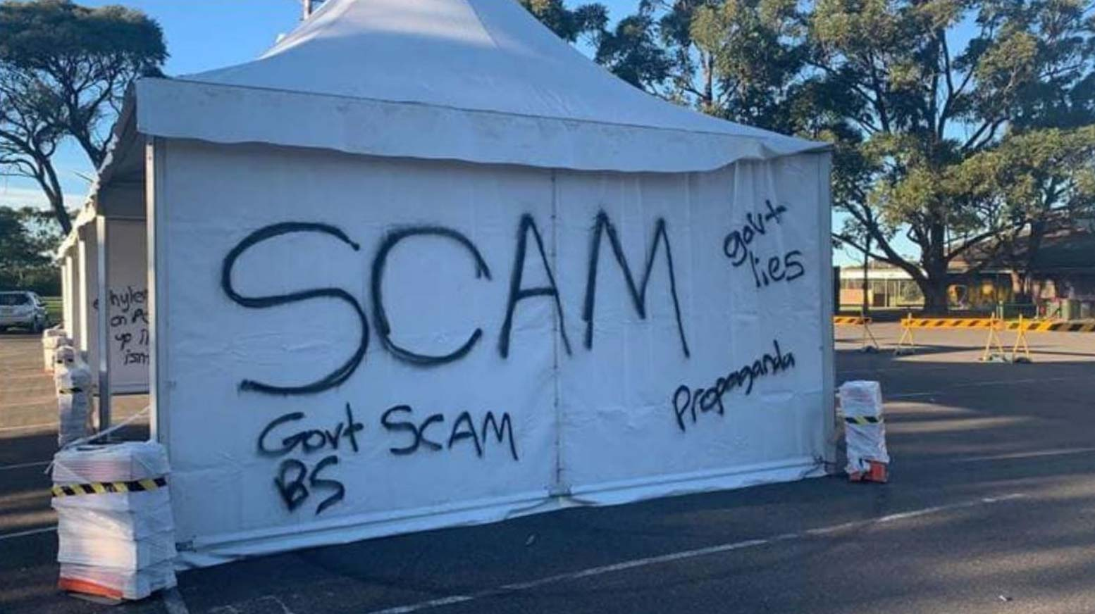 A pop-up COVID-19 testing site in Sydney's south has been targeted by vandals, calling the pandemic a government scam. (Facebook Diedree Steinwell)