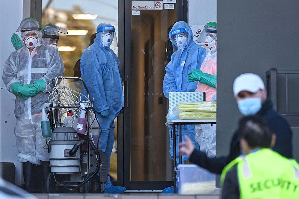 Cleaners and HAZMAT-suited health workers at a building in Devitt St, Blacktown, where a number of COVID-19 cases have been detected and the entire block is locked down._nick_moir