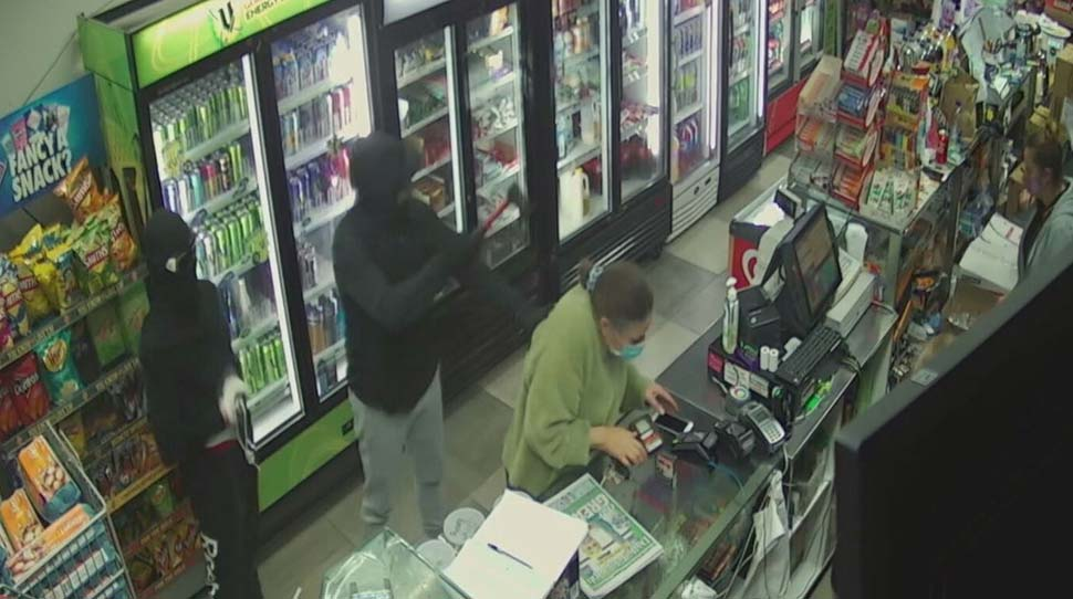 A pair of masked robbers were caught by CCTV as they stormed into a convenience store in Sydney's west._9NEWS