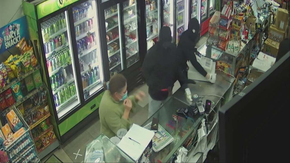 They threatened a customer and shop assistant with a machete and tomahawk before stealing the till. _9NEWS