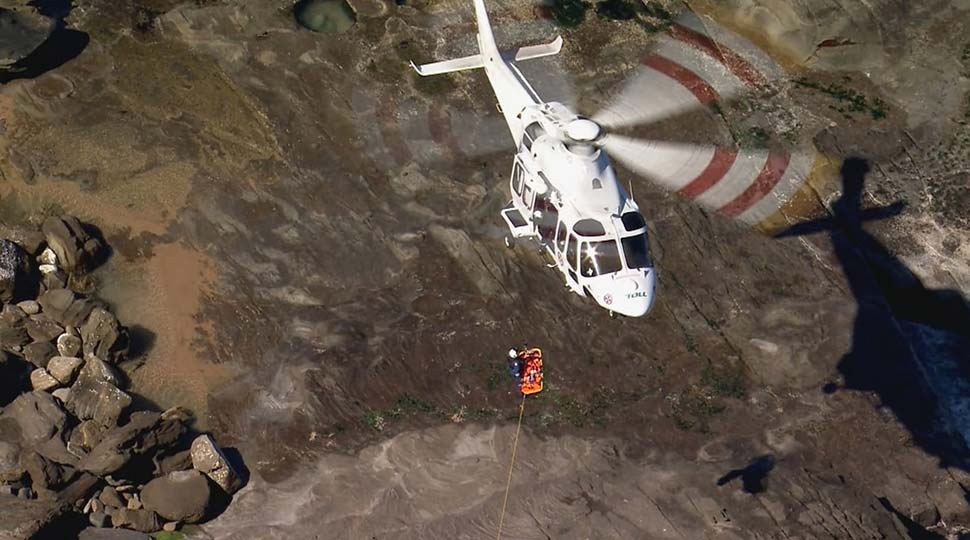 A woman has been rescued after being swept onto the rocks at Stanwell Park. (9News)