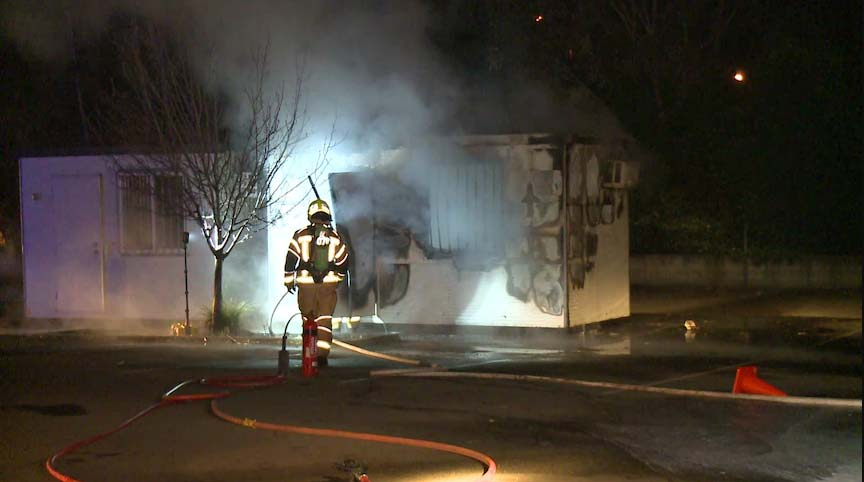 Firefighters extinguish a deliberately-lit blaze at a St Marys testing clinic.(ABC News)