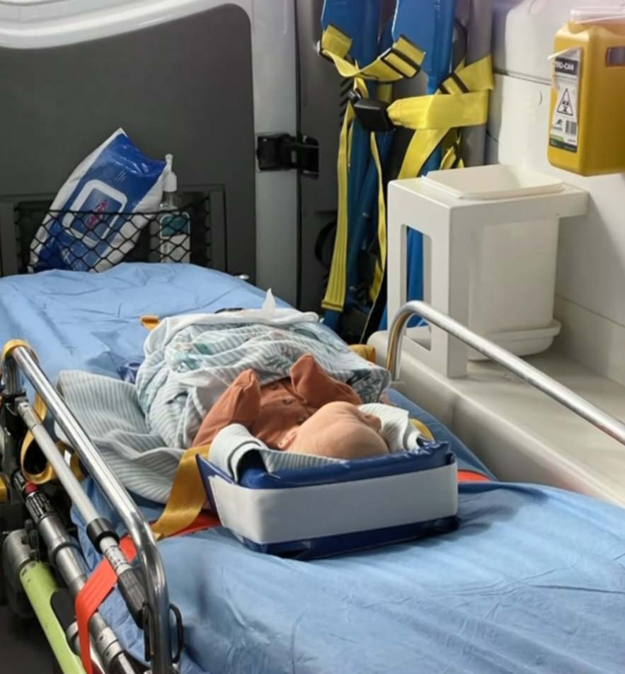 Little Hunter being transported in an ambulance to Campbelltown Hospital. Credit Supplied.