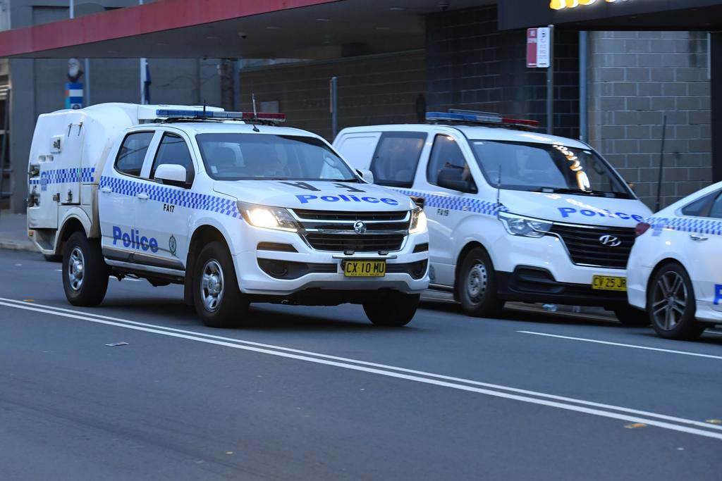 Police are seen beefing up their presence in south-west Sydney. Credit MICK TSIKASAAPIMAGE
