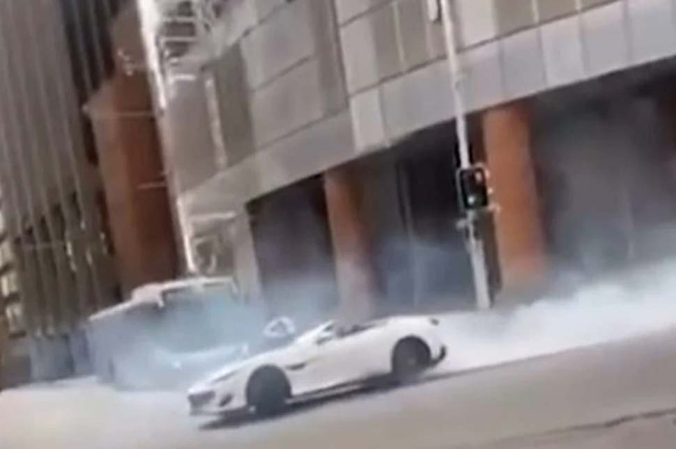 The 2019 Ferrari Portofino conducting burnouts in the intersection, resulting in smoke and blocked traffic.CREDITPOLICE MEDIA