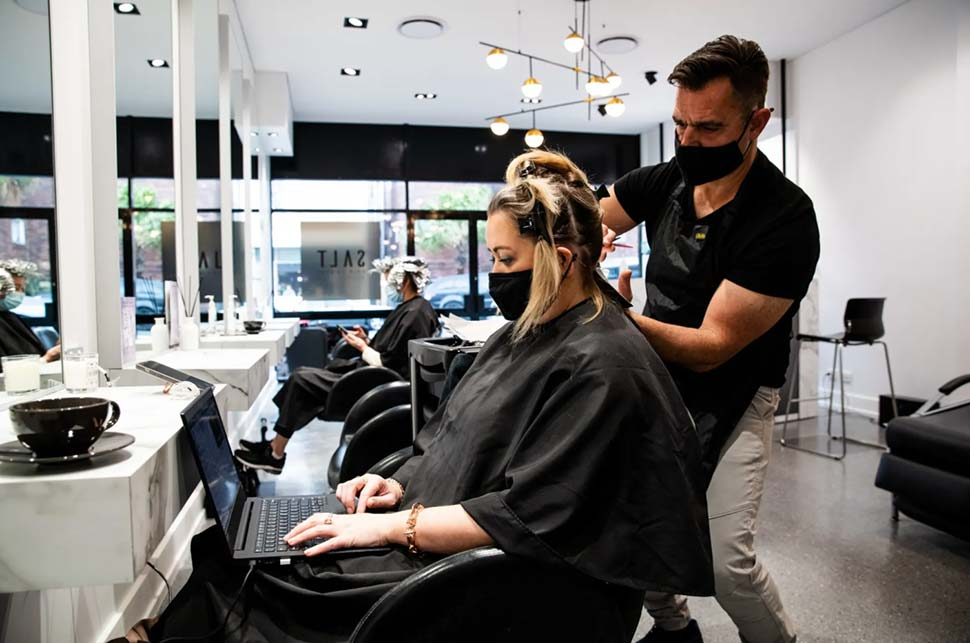Hairdresser Tony Boutsalis from Salt Hair in Coogee with customer Helen Appleton. CREDIT:EDWINA PICKLES
