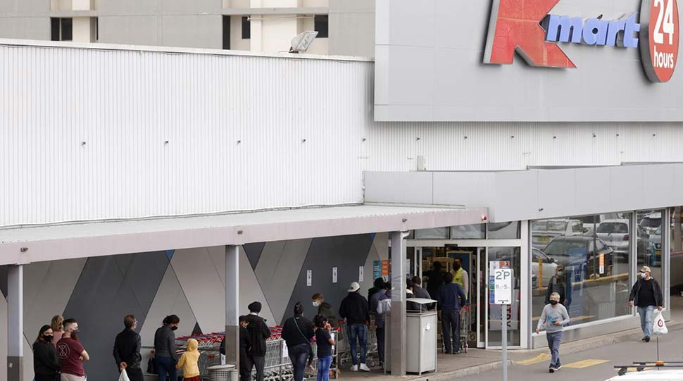 Queues stretch into Kmart Blacktown. Picture Jonathan Ng