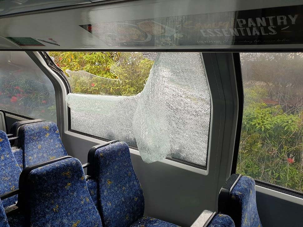 The rock narrowly missed a female passenger who was seated on the train at the time. (NSW Police)