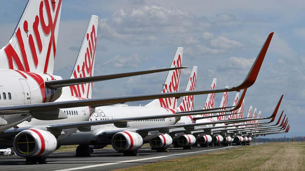 Virgin Australia jets sit idly. (AAP)